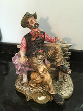 Large Capodimonte Figure Ornament Of A Tramp On A Bench With A Bottle Of Wine
