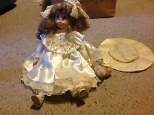"""Baby Doll with Porcelain ? Face, feet and hands.     17""""  long.  Used."""