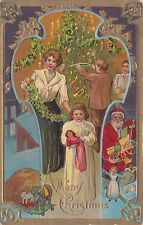 Vintage A Merry Christmas Post Card Family Trimming Christmas Tree Santa Claus