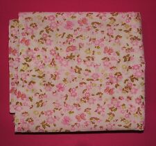 Fabric fat quarter with tiny pink flowers and butterflies on white background