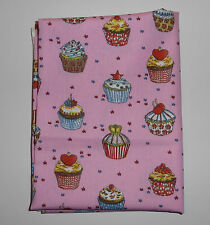 fat quarter with multicoloured cup cakes on bright pink background