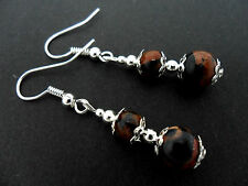 A PAIR OF BROWN/BLACK GOLDSTONE BEAD  AND SILVER  PLATED EARRINGS.