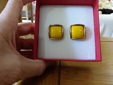 Brand new large gold look clip-on or pierced earrings with a large yellow stone