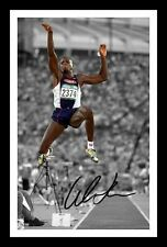 CARL LEWIS AUTOGRAPHED SIGNED & FRAMED PP POSTER PHOTO