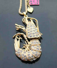 B549G     Betsey Johnson Crystal Enamel Lobster Pendant Sweater Chain Necklace