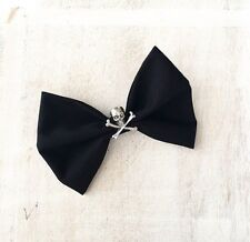 Black hair bow on clip with Skull and Crossbone - Pin up - Rockabilly