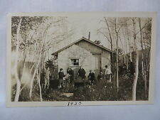 VINTAGE RPPC GROUP OF HUNTERS AT A CABIN IN THE WOODS NORTHERN MAINE? 1930