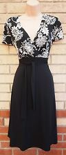 WALLIS PETITE BLACK FLORAL WHITE LYCRA BELTED V NECK FLIPPY SKATER DRESS 16 XL