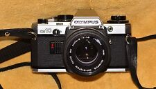 Olympus OM-10 35mm SLR Film Camera with 50 mm lens Kit and Case. Clean.