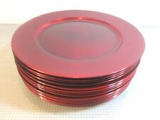 "EIGHT LACQUERED FINISHED RED PLATE CHARGERS 13"" IN DIAMETER."