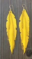 Zoë Battles Designs | molded feather hand made from leather. Yellow Colored