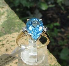 4.73 cts Genuine Swiss Blue Topaz Solitaire Size 7 Ring 10k Yellow Gold Accents