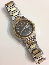 Seiko SQ Ladies Day Date Gold And Silver Working Quartz Watch