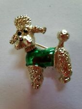 A beautiful silver tone and enamelled poodle brooch signed by Gerrys.