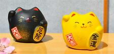 Maneki Neko Lucky cats black for protection yellow for good fortune in finance