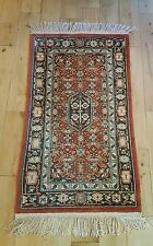 vintage Silk rug 48 inches x 27.5 inches. red brick colour mainly. quality. afga