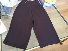 Woman's high waisted pants, brown color,  fluid material.