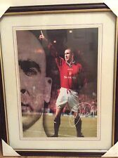 Eric Cantona at Manchester United signed photograph, framed.