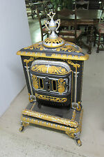 RESTORED ANTIQUE CAST IRON STOVE HAND PAINTED BY ARTIST HEAT RESISTANT PAINT
