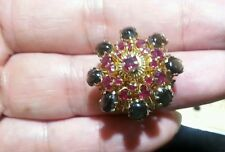 Antique 18k yellow gold ring With black star sapphires and rubies