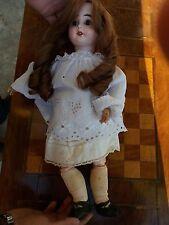 -  Jolie poupée ancienne  - tête porcelaine - articulée -