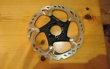 Shimano ice tech 160mm rotor with all fixings.  Removed from brand new bike
