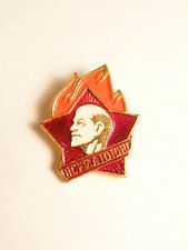 Soviet era pin with red star emblem and Lenin