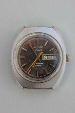 Action Automatic Tag und Datum, Herrenarmbanduhr, 1960er Jahre