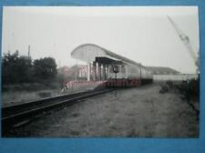 PHOTO  FALMOUTH RAILWAY STATION VIEW OF THE TOWN STATION WITH A DMU IN VIEW ON 9