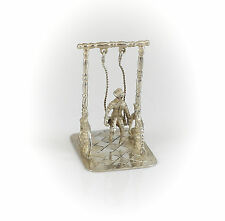 Dutch .934 Silver Miniature Boy Figural on Swing Figurine, c1922
