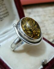 925 STERLING SILVER RING WITH COPAL/ AMBER IN OLIVE ,SIZE Q