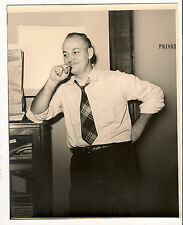 1940's photo of fellow dressed business casual and smoking in the office