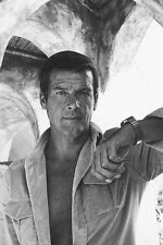 Roger Moore 11x17 Mini Poster in open shirt rugged 1970's pose