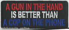 A GUN IN HAND IS BETTER THAN A COP ON THE PHONE - IRON-ON PATCH