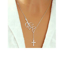 D31 Silver Cutout Leaf With Dangling Cross Necklace Boutique