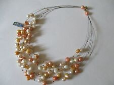 Collana acciaio e perle con palline d'oro. Necklace pearls on a steel wire