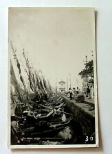 RPPC POSTCARD FISHING BOATS LINED UP AT PIER AFTER RETURNING PARA AMAZON BRAZIL