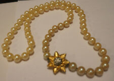 Vintage faux pearl necklace, knotted between each bead, very pretty clasp