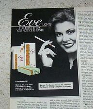 1984 vintage ad - Eve Cigarettes cute girl smoking tobacco print advertising