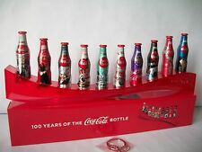 100 Years Of The Coca Cola Bottle Set 10 Mini Aluminum Bottles With Stand