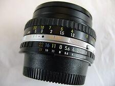 Nikon Series E  50mm    f:1.8   +  filter  caps