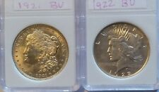 1921 Morgan Silver Dollar and a 1922 Peace Dollar