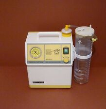 SAM 12 MEDICAL MOBILE SUCTION UNIT MGE SUCTION PUMP WITH CANISTER AND LINER