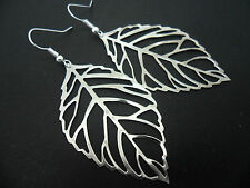 A PAIR OF  BIG  DANGLY SILVER COLOUR  LEAF  EARRINGS. NEW.