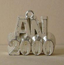 Fève en métal argenté pour l' An 2000 - An 2000