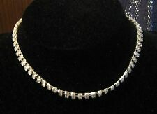 Wonderful silver tone metal choker style necklace with white stones