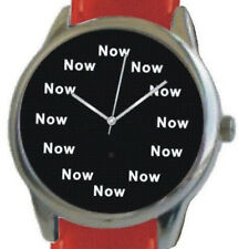 """NOW"" Is The Time On Each Hour Of The Large Polished Chrome Watch With Red Strap"