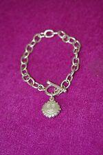 Silver coloured chunky bracelet with sun charm