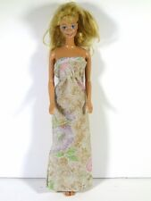 DRESSED BARBIE DOLL IN SILVER FLORAL DRESS