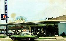 Photo. 1960s. Detroit, Michigan. Jim Causley Pontiac - Auto Dealership
